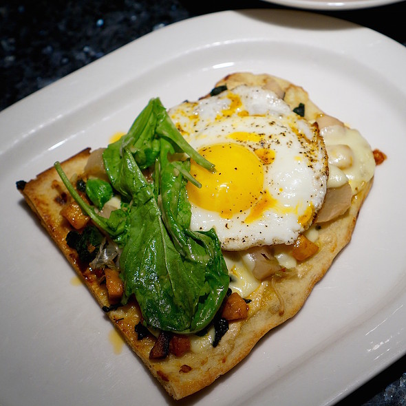 Wood-grilled flatbread, quark cheese, garlic conserva, hen egg, spinach, roasted kabocha squash, cheese curds, giardiniera, arugula, pickled artichoke vinaigrette, chili oil - Vie, Western Springs, IL