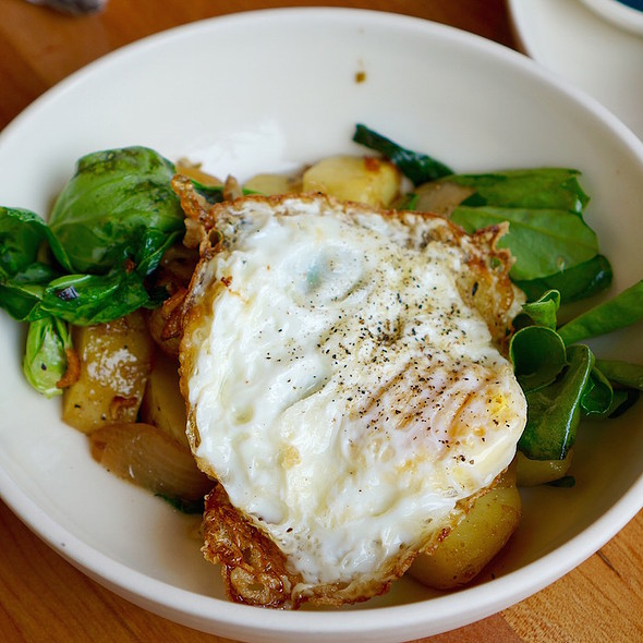 Breakfast hash – fava greens, onions, green garlic, maitake mushrooms, over easy egg, potatoes - Coquine, Toronto, ON