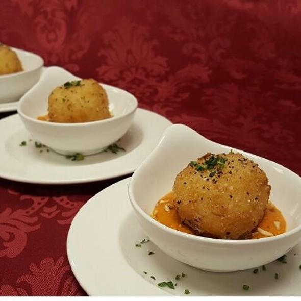 Manchego Stuffed Arancini with Romesco sauce - The Palace Restaurant and Saloon, Santa Fe, NM