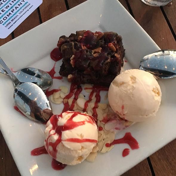 Chocolate Fudge Brownie With Raspberry Sauce And Vanilla Ice Cream - Belmont Brewing Company, Long Beach, CA