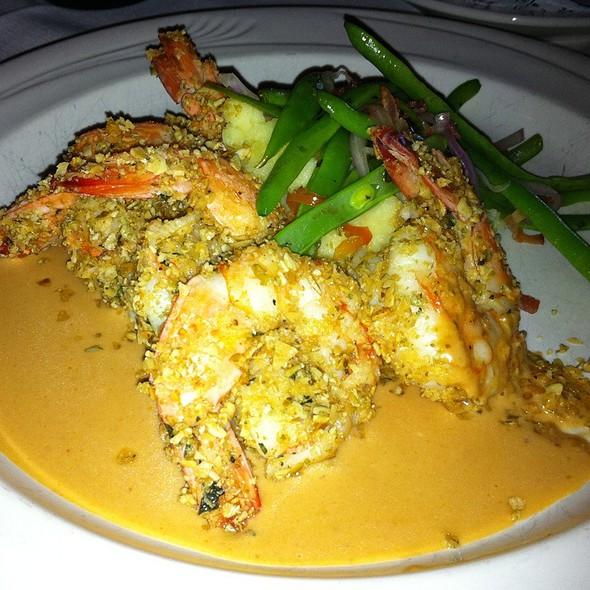 Pepita Crusted Jumbo Shrimp, Yukon Mashed Potatoes With A Smoked Tomato Chipotle And Bleu Cheese Sauce.  - Via Real, Irving, TX