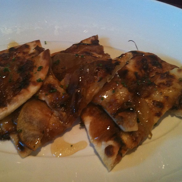 Flatbread W/ Gruyere, Caramelized Onions, Apples, & Truffle Honey - Stark's Steakhouse, Santa Rosa, CA